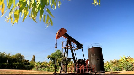 Oil Pumpjack (Sucker Rod Beam) on Sunny Day