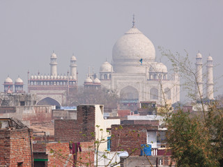 View of the Taj Mahal across Agra backstreets