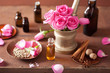 spa and aromatherapy set with rose flowers mortar and spices