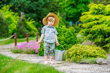 Cute country style kid with bucket and rod