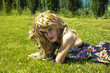 Drag queen lying on grass and looking