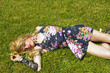 Drag queen lying on grass