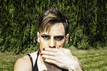 Drag queen covering her mouth