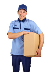Handsome young delivery man holding box