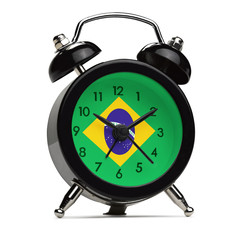 Old style alarm clock with the flag of Brazil