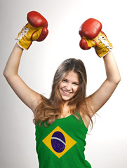 Success woman celebrating for her succes with the flag of Brazil