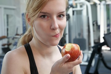 young beautiful woman eating an apple