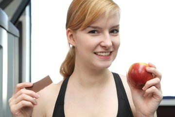 young beautiful woman with chocolate and an apple