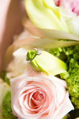 wedding ring and beautiful flowers.