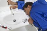 Young Professional plumber. Plumbing repair service. poster