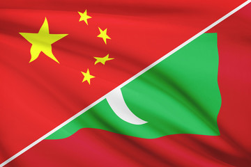 Series of ruffled flags. China and Republic of the Maldives.