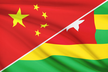 Series of ruffled flags. China and Republic of Togo.
