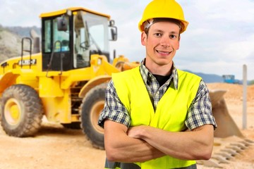 Portrait of a bulldozer driver,at construction site.