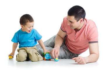 Father and kid play with car toys together