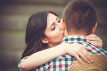 Young affectionate couple kissing tenderly