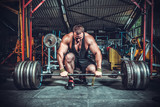 Fototapety Powerlifter with strong arms lifting weights