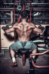 body builder doing heavy weight exercise for back