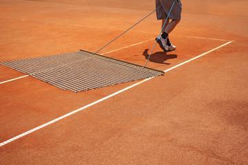Aligning tennis court