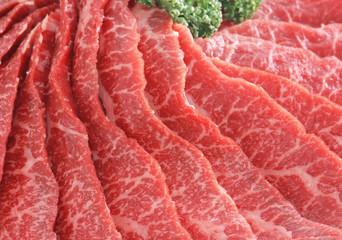 raw beef in wooden board