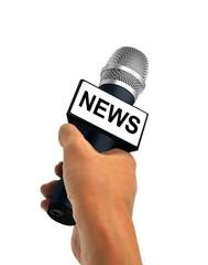 Hand Holding News Microphone