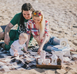 Happy family having picnic on a beach