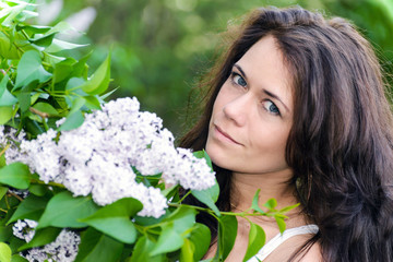 Girl near blossoming lilac