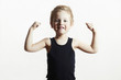 Isolate.Child.Funny Little Boy.Sport.Strong.bodybuilder.muscles