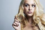 Beautiful funny woman.Flirt Blond Girl with Curly hair.Enjoy