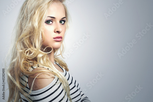 Beautiful blond woman.Curly hair. Beauty Girl.stripes.sailor