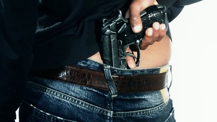man`s back with gun tucked in pants