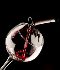 glass of red wine on black background