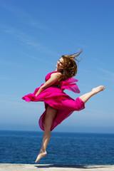 Young beautiful girl doing gymnastic