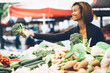 Young woman buying vegetables at farmers market - 65288060