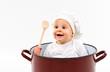 baby sitting inside a pot