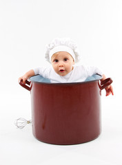 baby sitting inside a pot