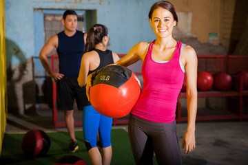 Happy girl with medicine ball