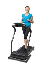 Young woman running on treadmill, isolated over white