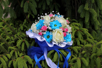 Wedding bouquet with daisies and roses on pine branch