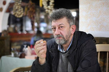 Smoking isues, adult man smoking in restaurant