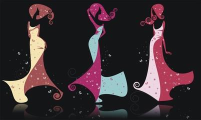 Три силуэта девушек в ярких платьях