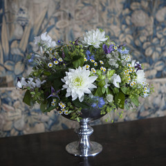 Vase with white chrysanthemum on a wooden background