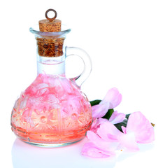 Rose oil in bottle isolated on white