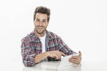 handsome young man using a digital tablet