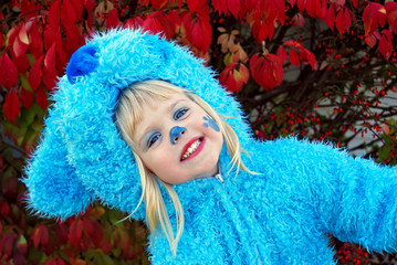 little girl in blue dog Halloween costume