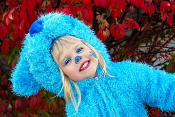 little girl in blue dog Halloween costume