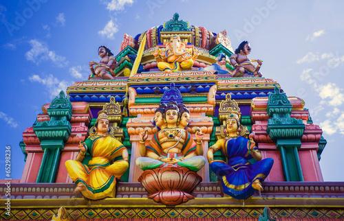 Facade of a Hindu temple in Sri Lanka with sculptures of deities - 65298236