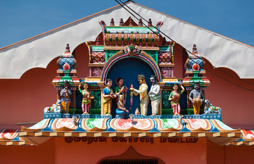 Hindu wedding place with various statues, facade and entrance