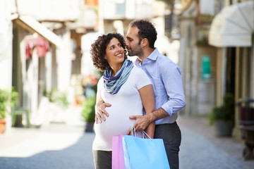 pregnant woman and man shopping in Italy