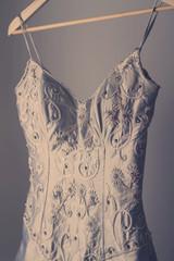 Stunning vintage wedding dress on a hanger