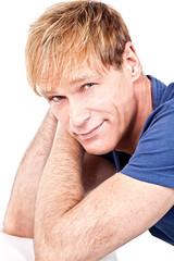 Portrait attractive middelaged man against white background